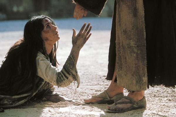 a los pies de jesus foto